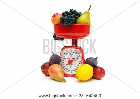 Kitchen Scale And Fruit Isolated On White Background. Horizontal Photo.