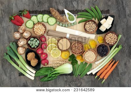 Macrobiotic health food concept with soba and udon noodles, wasabi and miso paste, tofu, vegetables, legumes, grains and seaweed with foods high in protein, antioxidants, vitamins and minerals.