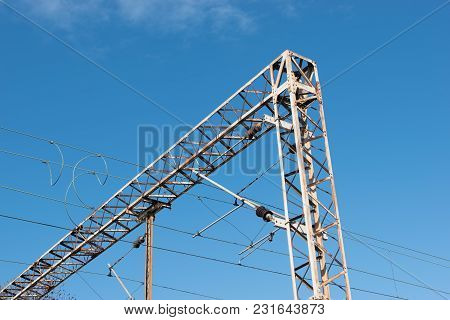 Train Or Railway Power Line Support. Railway Power Lines With High Voltage Electricity On Metal Pole