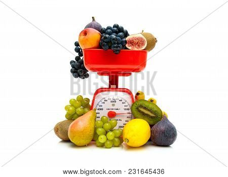 Fresh Fruit And Kitchen Scales On A White Background. Horizontal Photo.