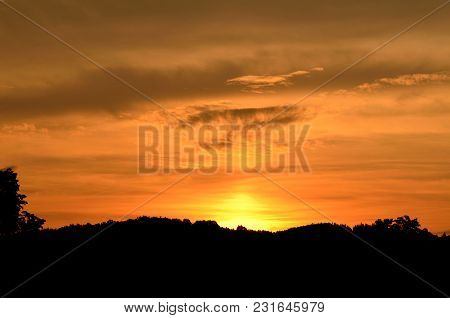 Beautiful Orange Sunset Over The Silhouetted Mountains Background, Wallpaper