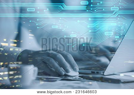 Hands Typing On Laptop Keyboard Placed On Abstract Background With Glowing Digtal Interface. Innovat