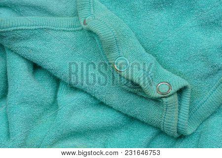 Green Texture Of Cloth Mint Of Old Clothes With Buttons