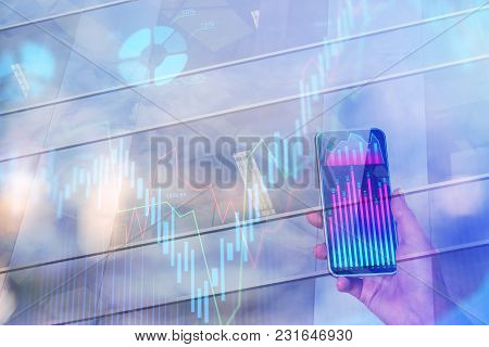 Hand Holding Smartphone With Business Chart On Abstract City Background With Forex Diagram. Technolo