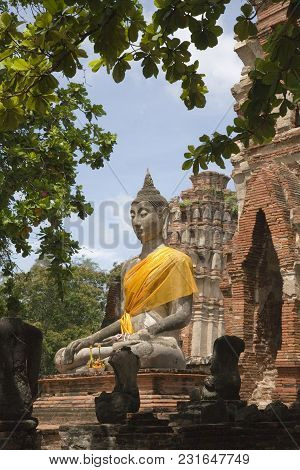 Statue Of Buddha At Arutthaya, The Ancient Capital Of Thailand, Which Is Now A Ruin And A World Heri