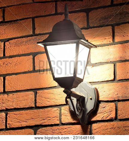 Old Lantern Lamp In Victorian Style On The Brick Wall