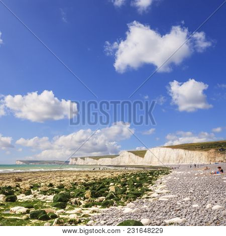 The Beach At Birling Gap, East Sussex, And The Chalk Cliffs Known As The Seven Sisters, On A Fine Su