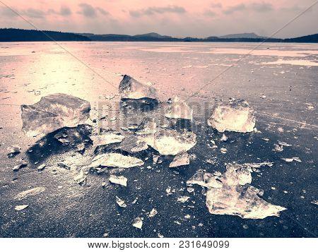 Broken Glacier In The Frozen Bay. Beautiful Winter Background. Marvelous Winter Scene With Marks Of