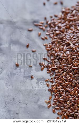 Selective Focus Close-up Picture Of Uncooked Healthy Nutritious Flax Seed On White Textured Backgrou