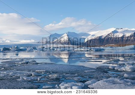 Jokulsarlon Glacial And Lagoon With Blue Sky Background, Iceland Winter Season Natural Landscape
