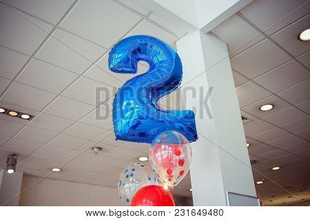 Blue Foil Number 2 (two) Balloon And Other Balloons Closeup. Decor For A Party.