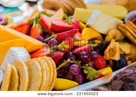 Fruit Salad And Cheese Board At Spring Festival Picnic Event