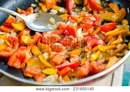 Carrot, Onion And Tomatoes Frying In Pan