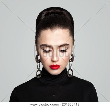 Elegant Retro Style Makeup With Eyeliner And Red Lips. Perfect Female Model Woman Looking Down