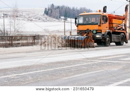 Miercurea Ciuc , Romania- 18 March 2018: Truck Plowing The Thick Ice Formed On Asphalt At Springtime