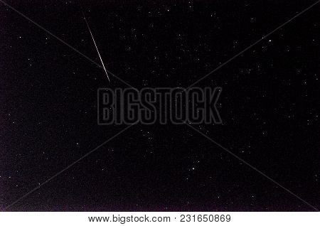 Meteor In Sky With A Lot Of Stars