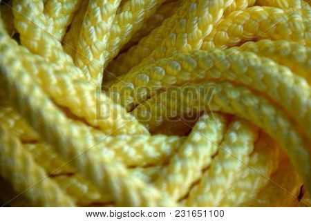 Abstract Yellow Background Of A Synthetic Or Nylon Rope
