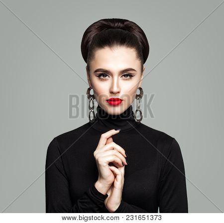 Fashion Portrait Of Elegant Woman. Girl With Makeup, Manicure And Hair Updo. Cute Model In Black Clo