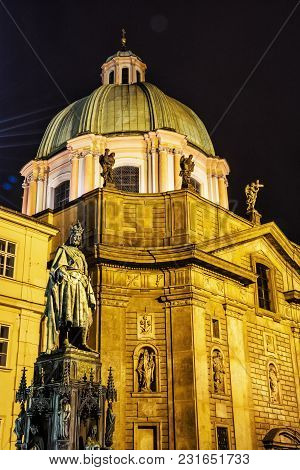 Charles Iv Statue And Church Of Saint Francis Of Assisi In Prague, Czech Republic. Night Scene. Reli
