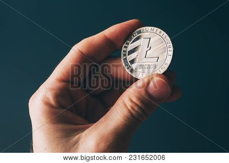 Litecoin Cryptocurrency In Hand, Blockchain Technology Decentralized Currency Coin