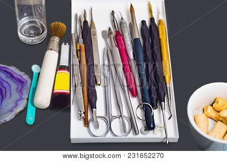 Various Tools On A Grey Table In A  Prosthetics Laboratory