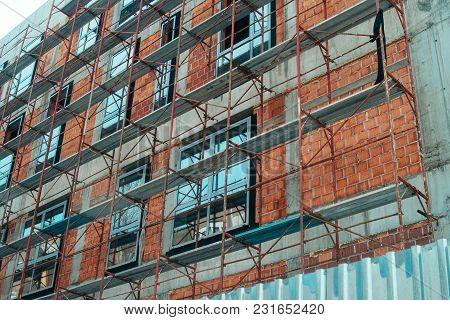 Apartment Building Construction Site With Industrial Scaffolding