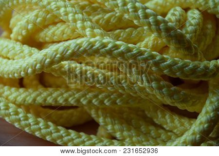 Yellow Background Of A Synthetic Or Nylon Rope