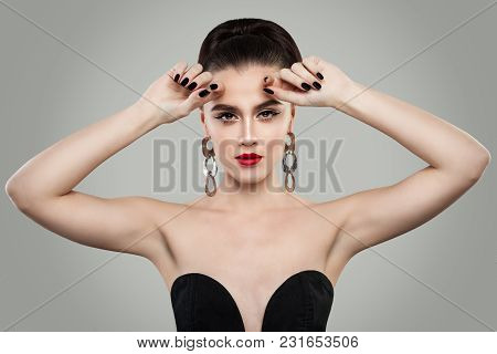 Fashion Portrait Of Beautiful Woman With Red Lips Makeup, Perfect Hairstyle And Manicure. Black Nail