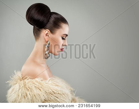 Luxurious Woman In Fur And Silver Jewelry