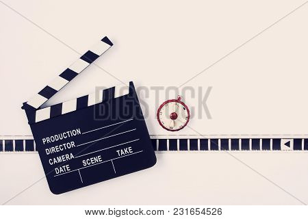 Clapperboard, A Piece Of Film And A Red Timer Lie On A Light Background