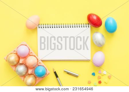 Flat Lay Top View Colorful Easter Egg Painted In Pastel Colors Composition And Mock Up Blank Noteboo