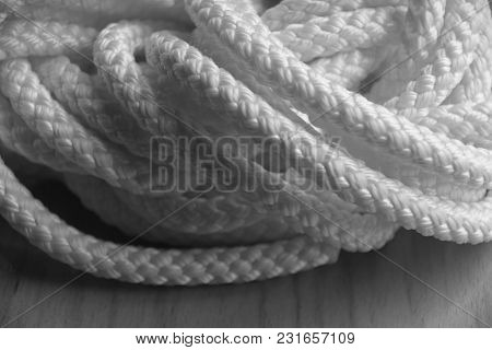 Synthetic Rope On Wooden Floor In Black And White Optic