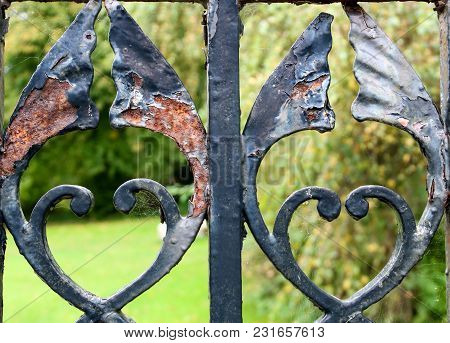 Old Rusting Iron Gate Detail In A Country Park