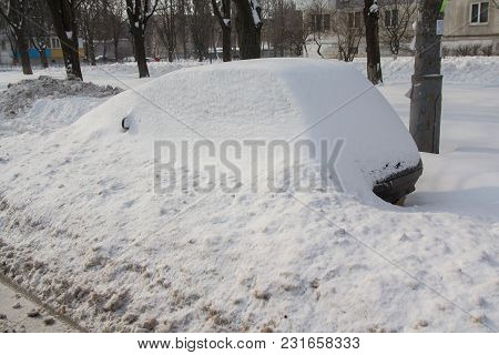 Abandoned Car Brought By Snow On A Roadside. Transport