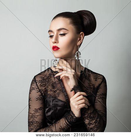 Beautiful Brunette Woman In Black Cocktail Dress. Fashion Portrait Of Brunette Hair Model