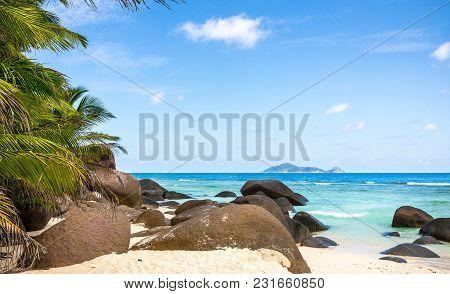 Paradise Island In The Seychelles, Sandy Beach And Blue Sky Over Indian Ocean