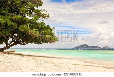 Paradise Sandy Beach And Turquoise Indian Ocean On Silhouette Island, Seychelles