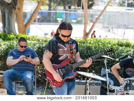Tel Aviv-yafo, Israel, March 17, 2018 :  A Guitarist From A Group Of Street Musicians Plays Music Fo