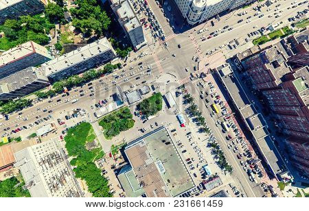 Aerial City View With Crossroads And Roads, Houses, Buildings, Parks And Parking Lots, Bridges. Urba