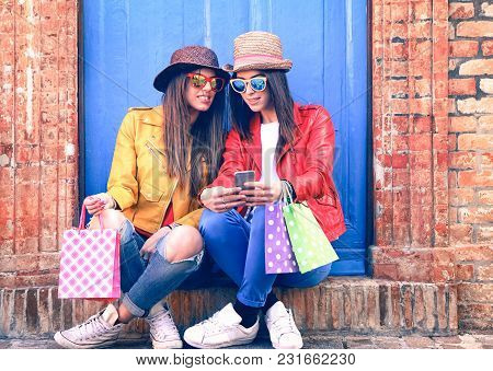 Trendy Clothing Women Looking Mobile Phone Holding Shoppers Sitting Outside House - Young Female Hip
