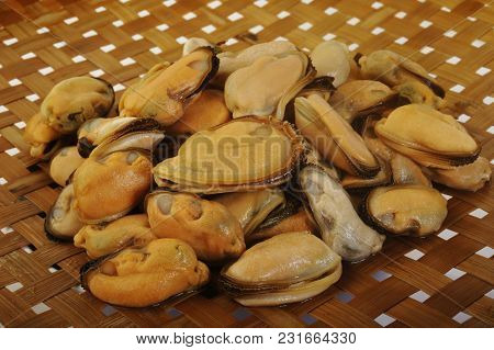 Peeled Frozen Mussels Seafood Uncook On Background