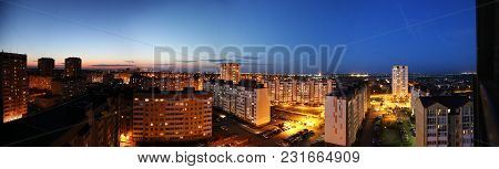 View From The Balcony On The City Skyline At Evening. Panorama View Of The City. Fires Of The Evenin