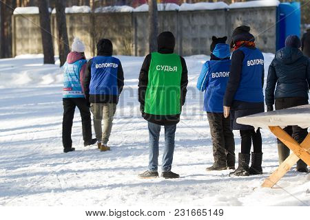 Kazan, Russia - March, 2018: Kazan Ski Marathon - Group Of Volunteer Waiting For Sportsmen, Telephot