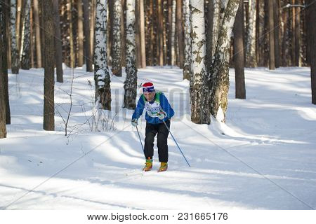 Kazan, Russia - March, 2018: Old Man Running Ski Marathon In Sunny Frozen Forest, Winter Sports And