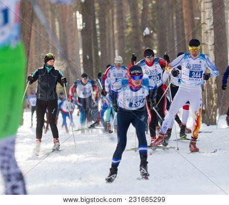 Kazan, Russia - March, 2018: Male Skiers Running Skiing In Winter, Ski Marathon, Winter Sports And C
