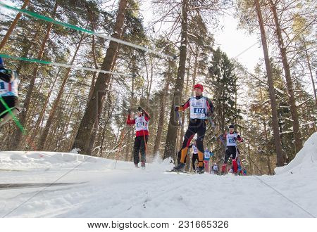 Kazan, Russia - March, 2018: Professional Winter Ski Race With Many Athletes Running One After The O