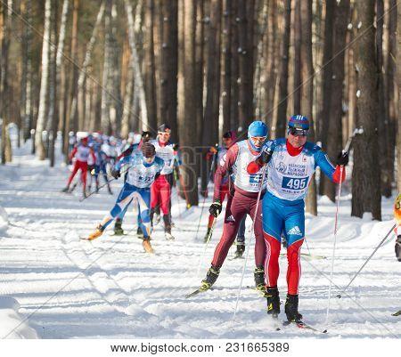 Kazan, Russia - March, 2018: Professional Athletes Skiers Running Ski Marathon, Winter Sports And Co