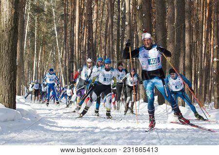 Kazan, Russia - March, 2018: Professional Sportsmen -athletes Skiers Running Ski Marathon, Winter Sp
