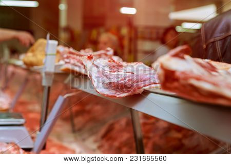 Butcher Cuts A Piece Of Meat In The Market The Hands Of A Butcher Cutting Slices Of Raw Meat