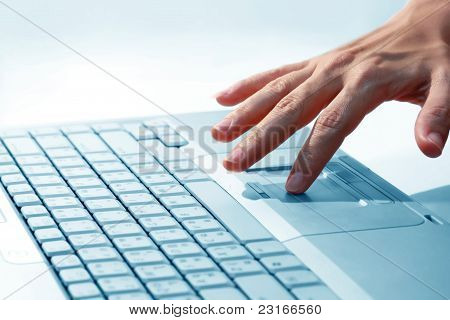Hand, women are using the computer.